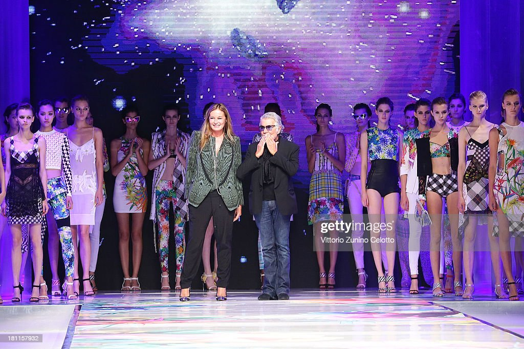 Italian designers Roberto Cavalli and Eva Düringer acknowledge the applause of the audience after the Just Cavalli show as a part of Milan Fashion Week Womenswear Spring/Summer 2014 on September 19, 2013 in Milan, Italy.