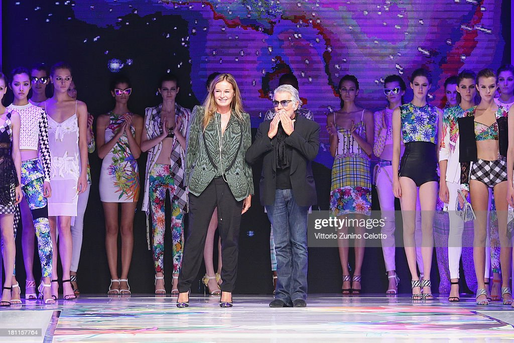 Italian designers Roberto Cavalli and wife Eva Düringer acknowledge the applause of the audience after the Just Cavalli show as a part of Milan Fashion Week Womenswear Spring/Summer 2014 on September 19, 2013 in Milan, Italy.