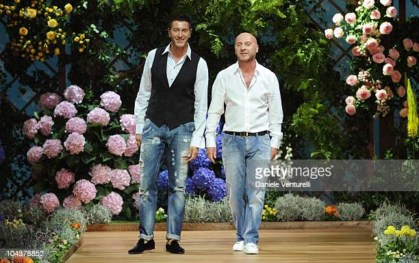 Italian Designers Stefano Gabbana and Domenico Dolce acknowledge the applause at the end of the DG Milan Fashion Week Womenswear S/S 2011 show on...