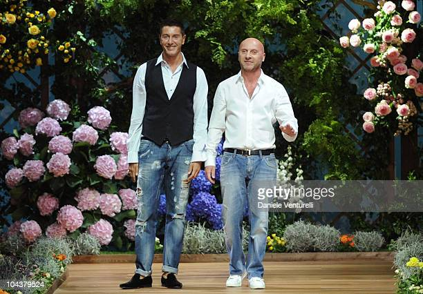 Italian Designers Stefano Gabbana and Domenico Dolce acknowledge the applauses at the end of the DG Milan Fashion Week Womenswear S/S 2011 show on...