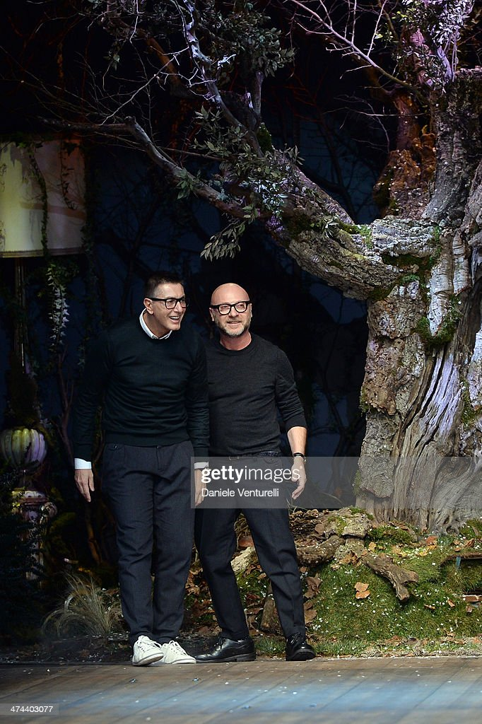 Italian designers Stefano Gabbana and Domenico Dolce acknowledge the applause of the audience after the Dolce & Gabbana show as part of Milan Fashion Week Womenswear Autumn/Winter 2014 on February 23, 2014 in Milan, Italy.