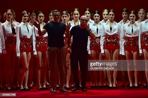 Italian designers Stefano Gabbana and Domenico Dolce greet the audience at the end of their show during the 2015 Spring / Summer Milan Fashion Week...