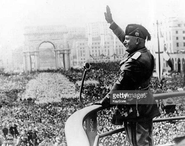 Italian dictactor Benito Mussolini saluting during a public address