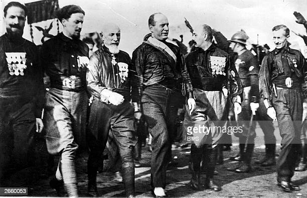 Italian dictator Benito Mussolini general and Fascist politician Emilio de Bono and aviator and politician Count Italo Balbo leading the blackshirts...