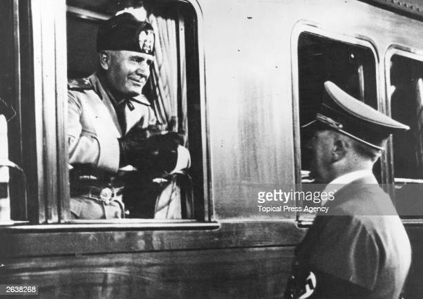 Italian dictator Benito Mussolini leaves Adolf Hitler at the station after a visit to Berlin Original Publication People Disc HW0225
