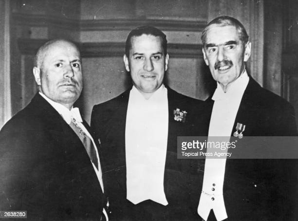 Italian dictator Benito Mussolini with British prime minister Neville Chamberlain and Count Galeazzo Ciano Mussolini's soninlaw at a reception given...