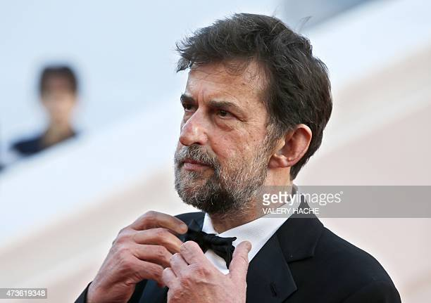 Italian director and actor Nanni Moretti adjusts his bowtie as he leaves the Festival palace after the screening of the film 'Mia Madre' at the 68th...