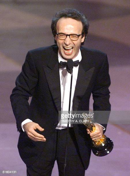 Italian director and actor Roberto Benigni holds his Oscar after winning for Best Performance by an Actor in a Leading Role for his part in the movie...