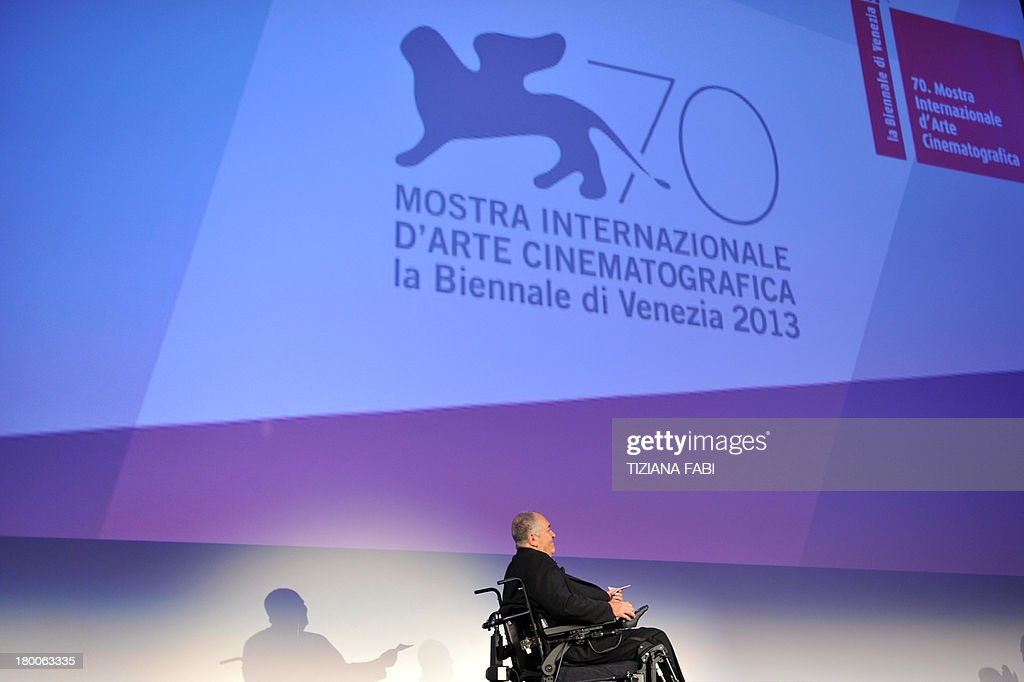Italian director and president of the jury Bernardo Bertolucci arrives on stage for the award ceremony of the 70th Venice Film Festival on September 7, 2013 at Venice Lido.