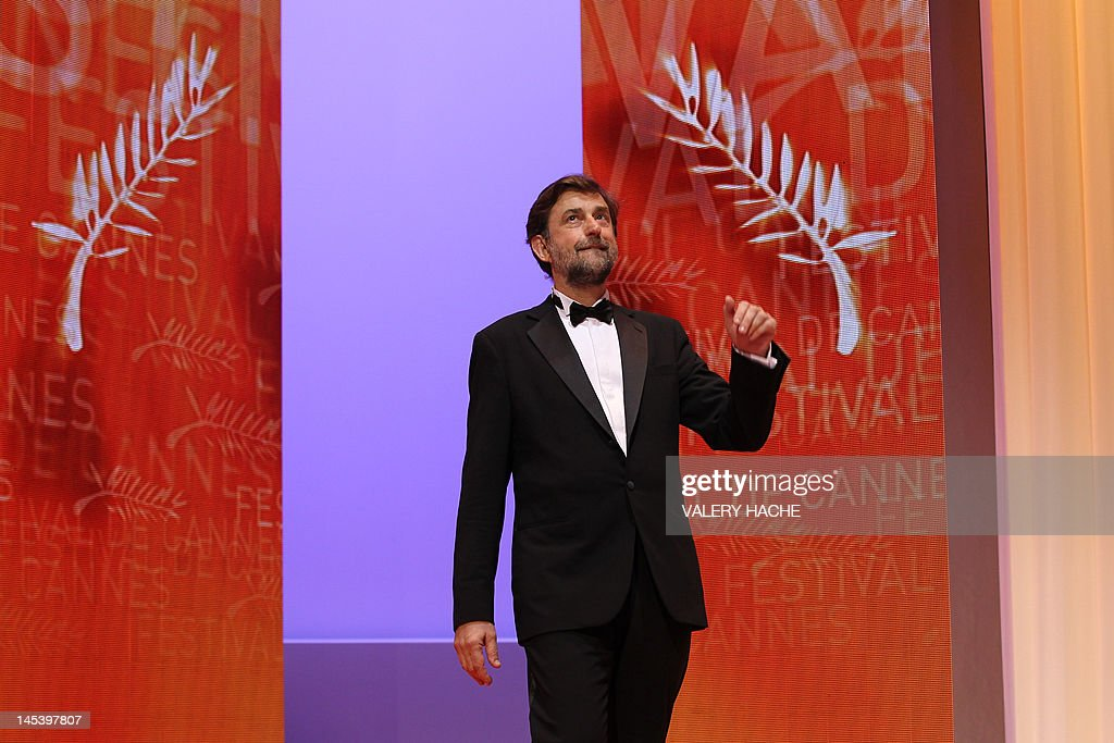 Italian director and president of the Jury, Nanni Moretti arrives on stage during the closing ceremony of the 65th Cannes film festival on May 27, 2012 in Cannes. AFP PHOTO / VALERY HACHE