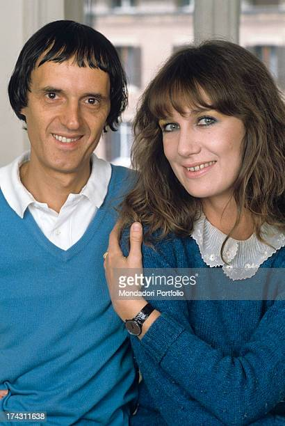 Italian director and scriptwriter Dario Argento and his wife the Italian actress Daria Nicolodi smiling and posing 1984