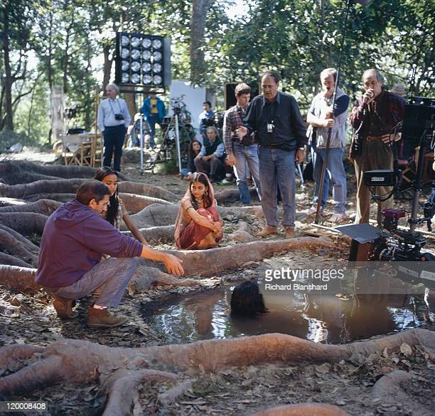 Italian director Bernardo Bertolucci prepares to film the temptation scene for the film 'Little Buddha' circa 1992