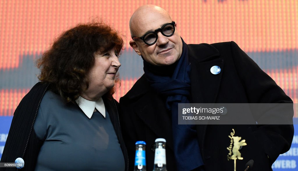 Italian director Gianfranco Rosi (R) and producer Donatella Palermo attend a press conference for the film 'Fuocoammare' (Fire At Sea) screened in competition at the 66th Berlinale Film Festival in Berlin on February 13, 2016. / AFP / TOBIAS SCHWARZ