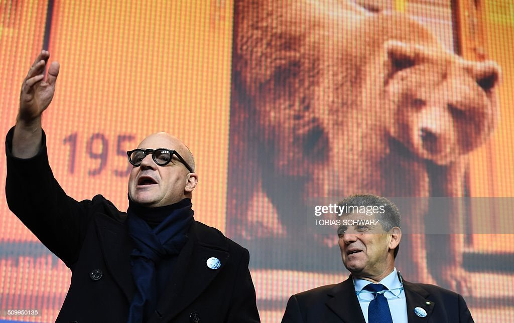 Italian director Gianfranco Rosi (L) and protagonist Pietro Bartolo attend a press conference for the film 'Fuocoammare' (Fire At Sea) screened in competition at the 66th Berlinale Film Festival in Berlin on February 13, 2016. / AFP / TOBIAS SCHWARZ