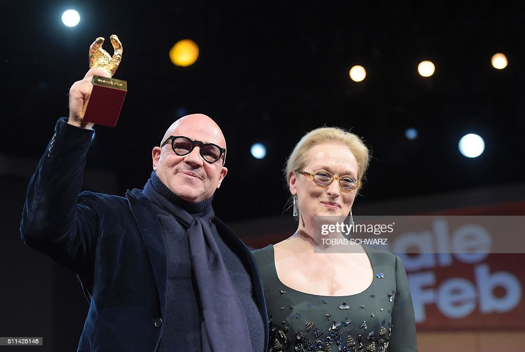 Italian director Gianfranco Rosi holds his Golden Bear for Best Film next to US actress and jury president Meryl Streep after receiving it for the...