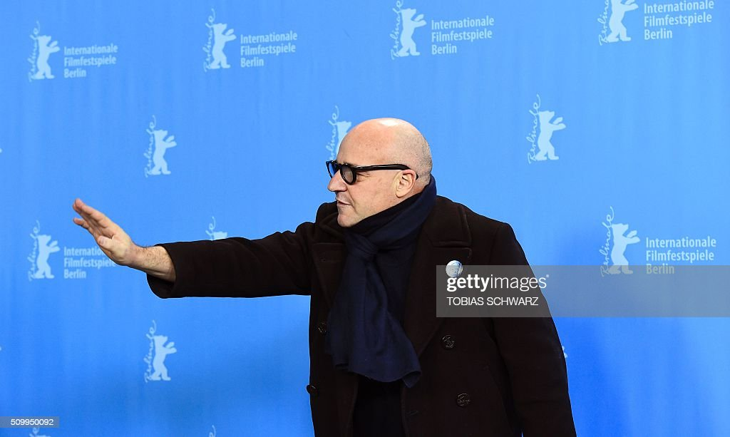 Italian director Gianfranco Rosi poses during a photo call for the film 'Fuocoammare' (Fire At Sea) in competition at the 66th Berlinale Film Festival in Berlin on February 13, 2016. / AFP / TOBIAS SCHWARZ