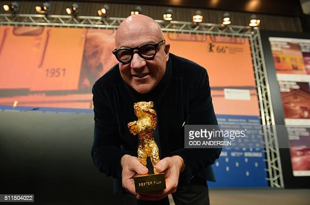 Italian director Gianfranco Rosi poses with his Golden Bear trophy for Best Film for the film 'Fuocoammare ' after the awards ceremony of the 66th...