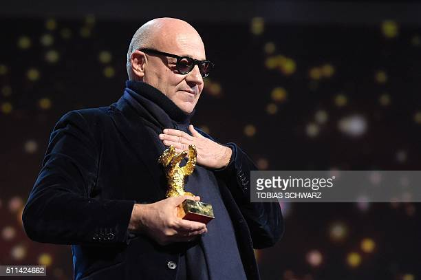 TOPSHOT Italian director Gianfranco Rosi reacts after receiving the Golden Bear for Best Film for the film 'Fuocoammare ' during the awards ceremony...