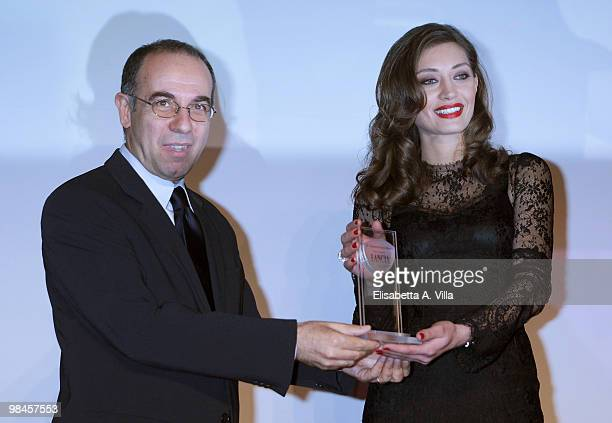 Italian director Giuseppe Tornatore gives the award to actress Margareth Made during the '2010 Premio Afrodite' cerimony at the Studios on April 14...
