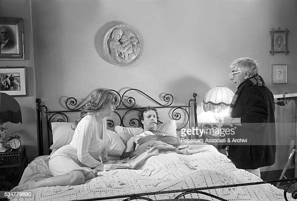 Italian director Lina Wertmuller preparing a scene with italian actors Veronica Lario and Enrico Montesano on the set of Softly Softly Italia 1984