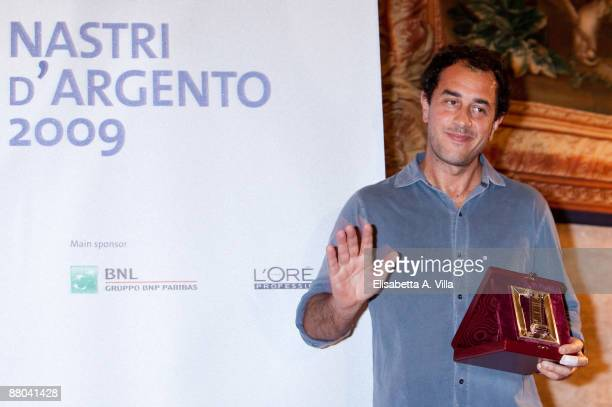 Italian director Matteo Garrone receives the award for the movie 'Gomorra' during the 2009 Nastri D'Argento Nominations Dinner Party at Villa Medici...