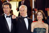Italian director Paolo Sorrentino and actors Anna Bonaiuto and Toni Servillo pose as they arrive to attend the screening of their film 'Il Divo' at...