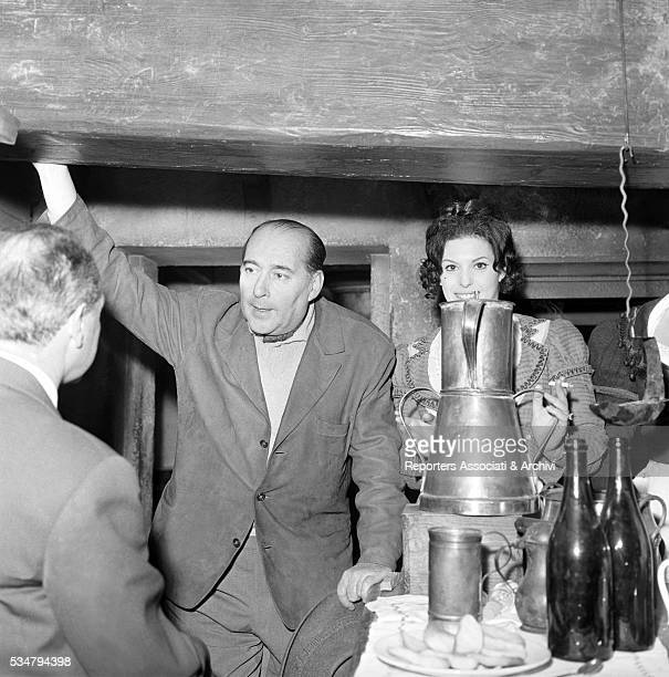 Italian director Roberto Rossellin and American actress and soprano Anna Moffo attending a party held for the film The Betrayer 1961