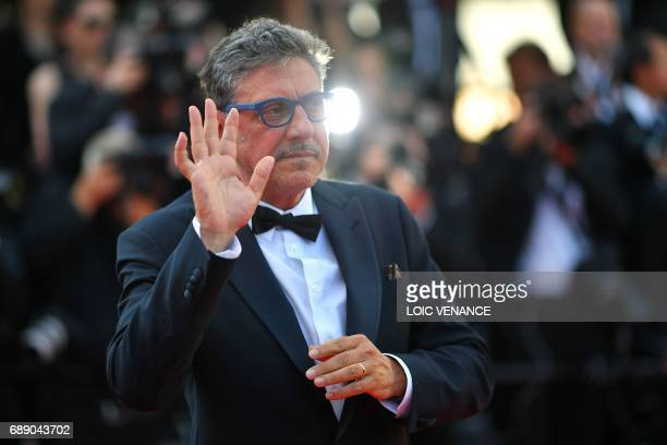 Italian director Sergio Castellitto waves as she arrives on May 27 2017 for the Un Certain Regard prize ceremony at the 70th edition of the Cannes...