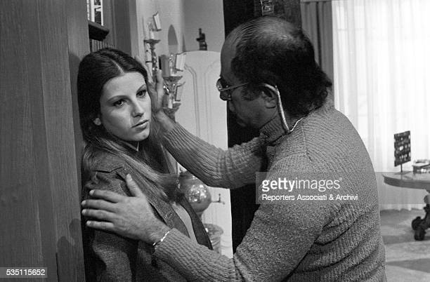 Italian director Sergio Sollima showing how to shoot a scene to Italian actress Stefania Sandrelli on the set of the film Devil in the Brain 1972