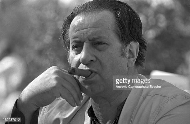 Italian director Tinto Brass smoking a cigar Lido Venice 1984