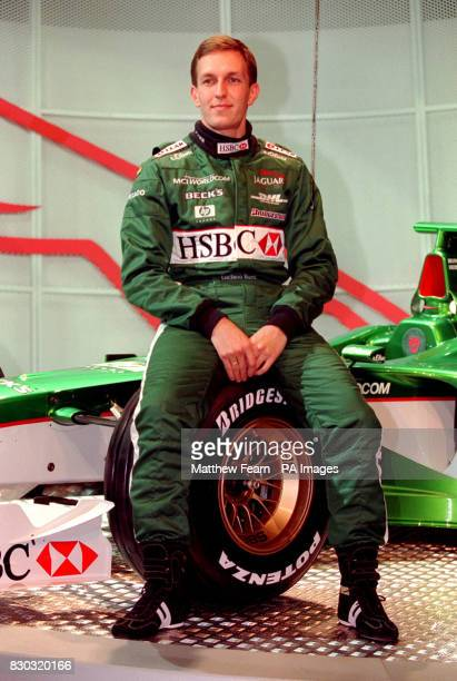 Italian driver Luciano Burti sits on the wheel of the new Jaguar R003 Formula 1 racing car which was unveiled in Central London The car will compete...