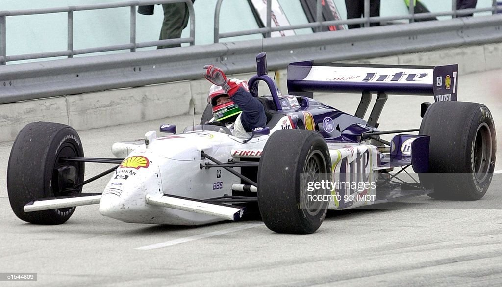 Italian driver Max Papis of FordCosworth/Reynard raises his arms as he drives his race car into the pitt lane as he celebrates crossing the finish...