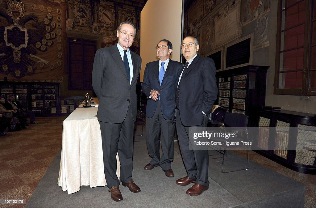 Italian economist Pietro Modiano, ex prime minister <a gi-track='captionPersonalityLinkClicked' href=/galleries/search?phrase=Romano+Prodi&family=editorial&specificpeople=203301 ng-click='$event.stopPropagation()'>Romano Prodi</a> and journalist Marco Panara attend the presentation of the book 'La Malattia dell'Occidente' (The Disease Of The West) at Stabat Mater Hall of Archiginnasio on November 24, 2010 in Bologna, Italy.