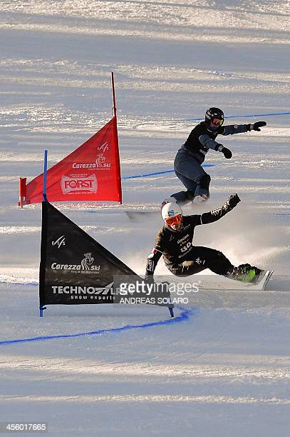 Italian Edwin Coratti clears a gate during the Men's Snowboard FIS World Cup Parallel Giant Slalom race in Carezza in the Dolomites on December 13...