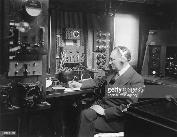 Italian electrical engineer Guglielmo Marconi at work in the wireless room of his yacht Electra