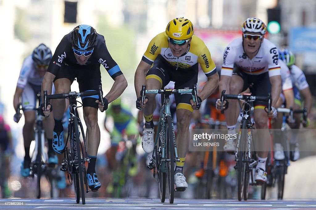 Italian Elia Viviani winner of the stage rides with second Dutch Moreno Hofland and third German Andre Greipel during the sprint of the 2nd stage...