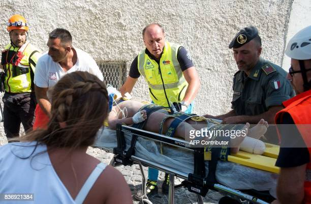 TOPSHOT Italian emergency workers evacuate on a stretcher Mattias a 7 yearold boy who was trapped by rubble in Casamicciola Terme on the Italian...