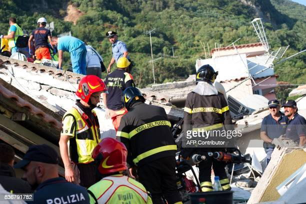TOPSHOT Italian emergency workers firemen and police officers search through rubble of a collapsed house in Ischia on August 22 after an earthquake...
