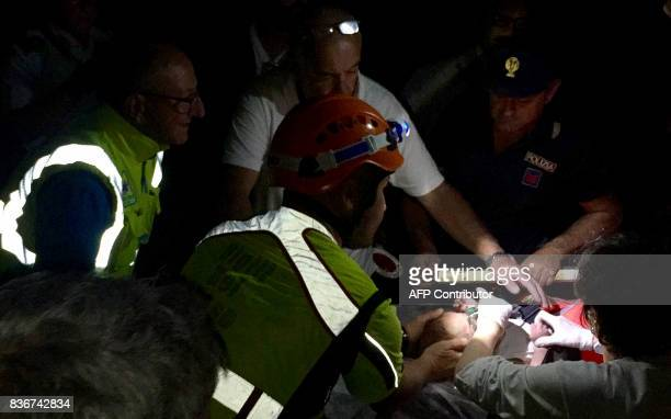TOPSHOT Italian emergency workers rescue a baby after an earthquake hit the popular Italian tourist island of Ischia off the coast of Naples causing...