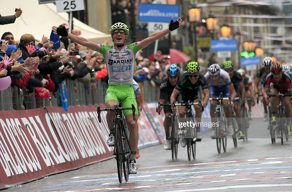 Italian Enrico Battaglin crosses the finish line to win the 246km fourth stage of the 96th Giro d'Italia from Policastro Bussentino to Serra San Bruno on May 7, 2013. Enrico Battaglin claimed his maiden Giro d'Italia stage on Tuesday with fellow Italian Luca Paolini retaining the leader's pink jersey and race favourite Bradley Wiggins losing time to rivals after an epic 246km of racing from Policastro to Serra San Bruno.