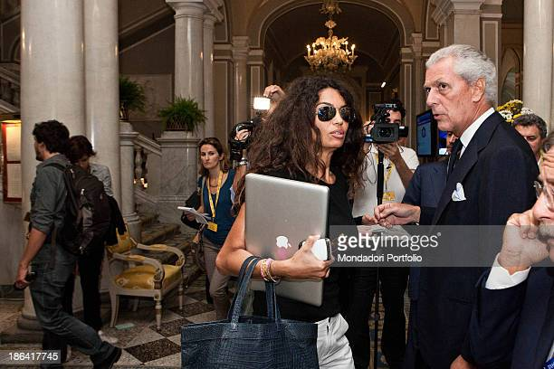Italian entrepreneur and chairman of Pirelli Marco Tronchetti Provera talking with his wife Tunisianborn Italian model and TV presenter Afef Jnifen...