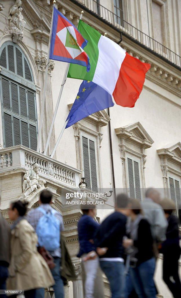 Italian, European and Italy's presidential flags fly on the Quirinale Palace, the presidential official residence, on April 20, 2013 in Rome. The election of Italy's President at the Italian parliament entered a chaotic third day today, with the left in total disarray after its leaders resigned over failure to get their candidates elected. The situation deepened a political crisis triggered by a general election two months ago that left no clear winner to govern the country. Ex-trade union leader Franco Marini and widely respected former European Commission chief Romano Prodi have both now withdrawn their candidacies to be president, and the top-selling Corriere della Sera daily said the country was 'suspended in a void'.