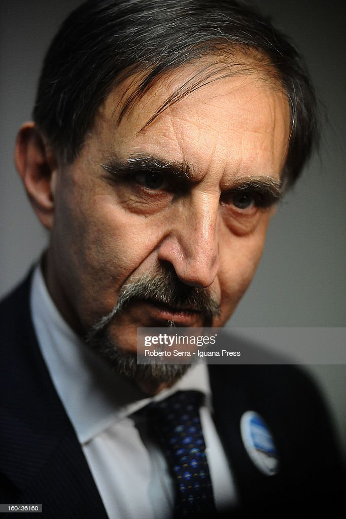 Italian ex Defence Minister in past government <a gi-track='captionPersonalityLinkClicked' href=/galleries/search?phrase=Ignazio+La+Russa&family=editorial&specificpeople=643246 ng-click='$event.stopPropagation()'>Ignazio La Russa</a> now candidate in next political elections to Italian Parliament attends a meeting with his supporters of Fratelli d'Italia party at their electoral headquarters on January 31, 2013 in Bologna, Italy. The general election in Italy is Febrary 24-25.