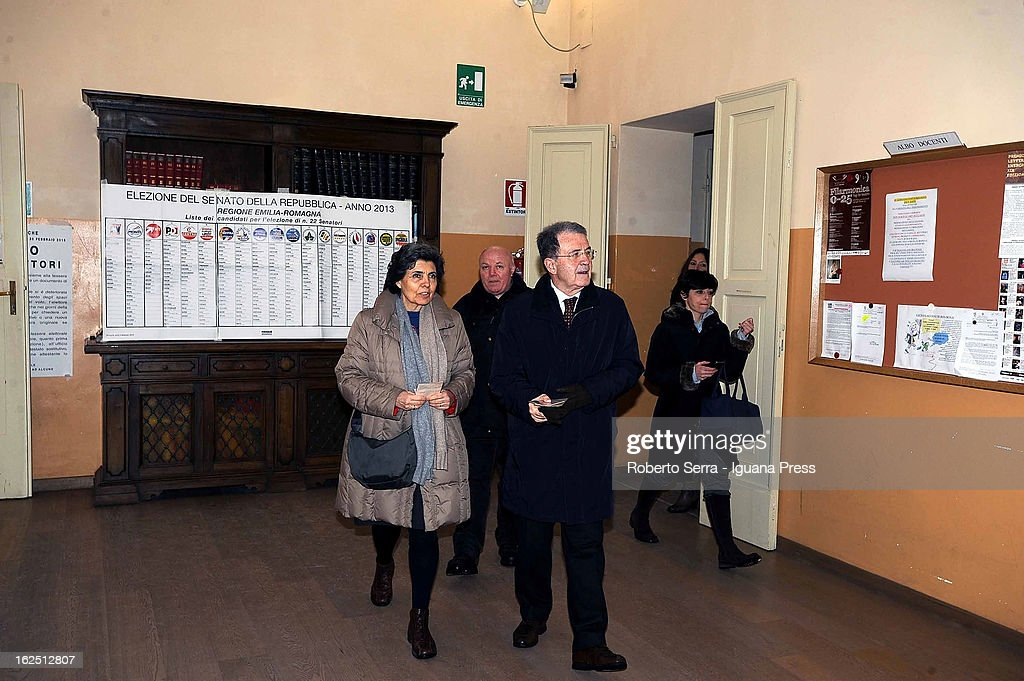 Italian ex Premier Romano Prodi (C) go to voting station with his wife Flavia Franzoni (L) on February 24, 2013 in Bologna, Italy. Italians are heading to the polls today to vote in the elections, as the country remains in the grip of economic problems. Pier Luigi Bersani's centre-left alliance is believed to be a few points ahead of the centre-right bloc led by ex-Prime Minister Silvio Berlusconi.