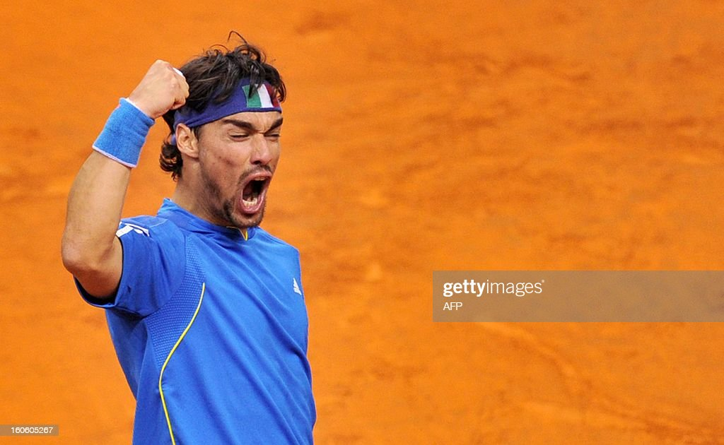 Italian Fabio Fognini celebrates after winning his Davis Cup tennis match against Croatian Ivan Dodig on February 3, 2013 in Turin.