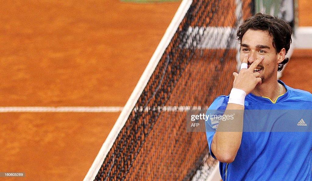 Italian Fabio Fognini celebrates after winning his Davis Cup tennis match against Croatian Ivan Dodig on February 3, 2013 in Turin. AFP PHOTO / TIZIANA FABI