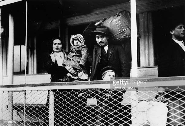 An Italian immigrant family on board a ferry from the docks to Ellis Island New York