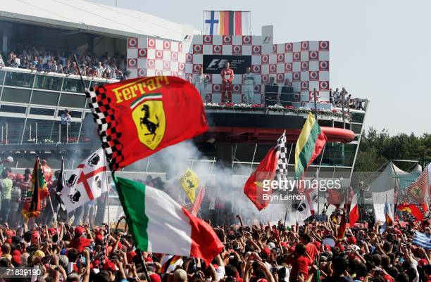 Italian fans celebrate Michael Schumacher's win in the Italian Formula One Grand Prix at the Autodromo Nazionale Monza on September 10 2006 in Monza...