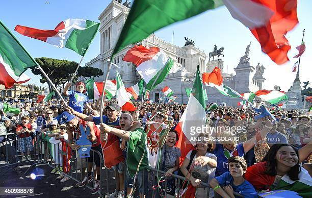 Italian fans watch on a giant screen the World Cup football match Italy vs Costa Rica on June 20 2014 on the Piazza Venezia square in Rome AFP PHOTO...