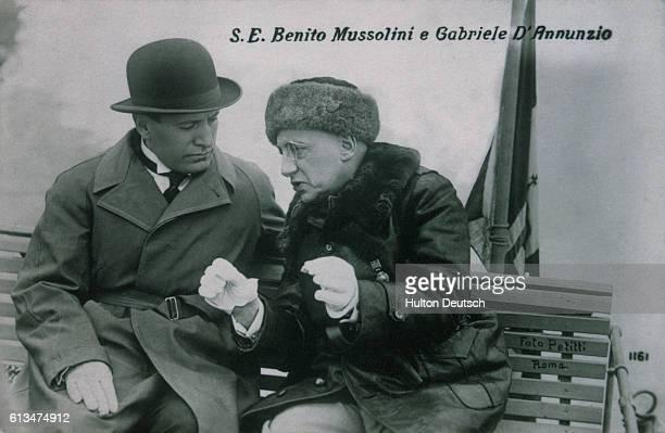 Italian Fascist leader Benito Mussolini talks with Gabriele D'Annunzio